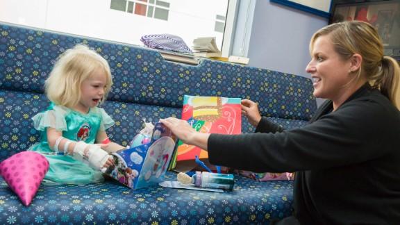 Kara Dixon, a cancer unit nurse, helped Willow open gifts.