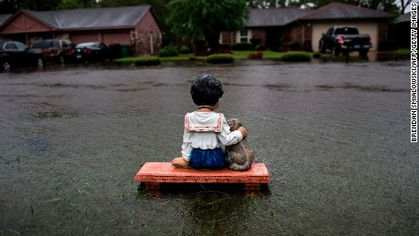 A lawn ornament is seen on a flooded street during the aftermath of Hurricane Harvey in Houston, Texas. Harvey has set w
