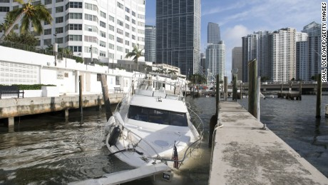 Partially submerged boats caused by Hurricane Irma sit in the water in a marina in downtown Miami, Florida, September 11, 2017. / AFP PHOTO / SAUL LOEB        (Photo credit should read SAUL LOEB/AFP/Getty Images)