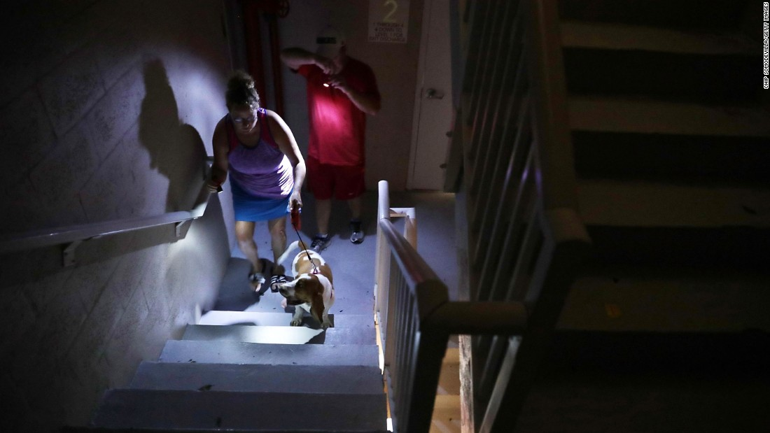 Hotel guests navigate a dark stairwell after they lost power in Fort Lauderdale, Florida.