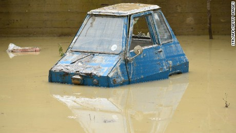 A partially submerged car in the Livorno area, flooded after heavy rain.