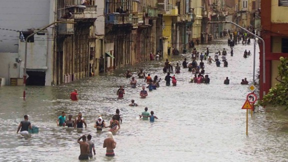 People move through flooded streets in Havana after the passage of Hurricane Irma on Sunday.
