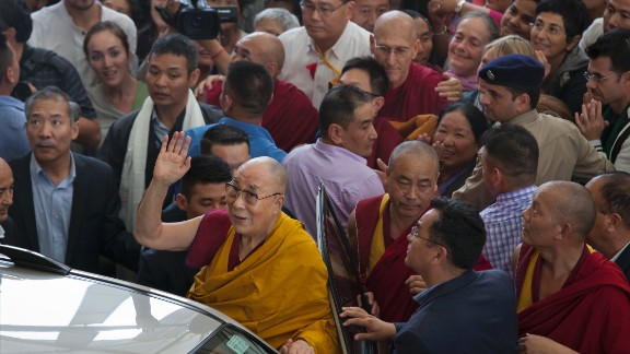 Tibetan spiritual leader the Dalai Lama greets devotees as he leaves the Tsuglakhang temple in Dharmsala, India, Friday, September 1.