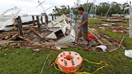A man walks by damage from Hurricane Irma at Sundance Marine in Palm Shores, Florida on September 11.