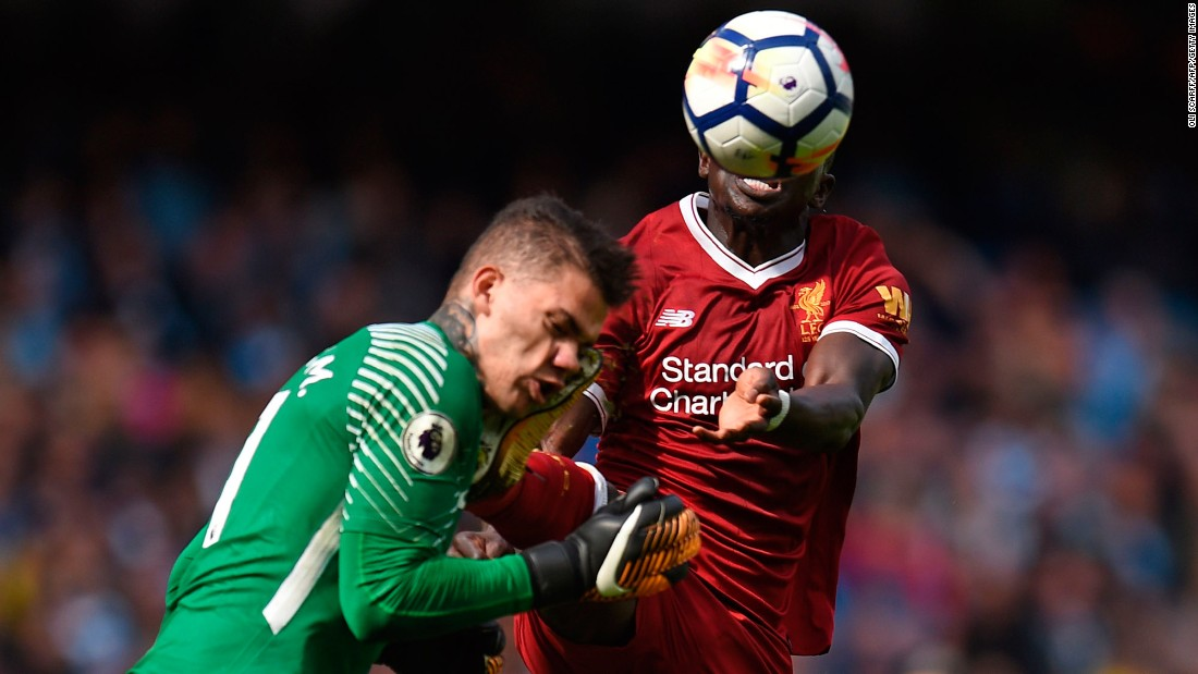 Manchester City goalkeeper Ederson gets kicked in the face by Liverpool's Sadio Mane during a Premier League match in Manchester, England, on Saturday, September 9. Mane received a red card for the high challenge, which he apologized for and said was accidental. Ederson was stretchered off.
