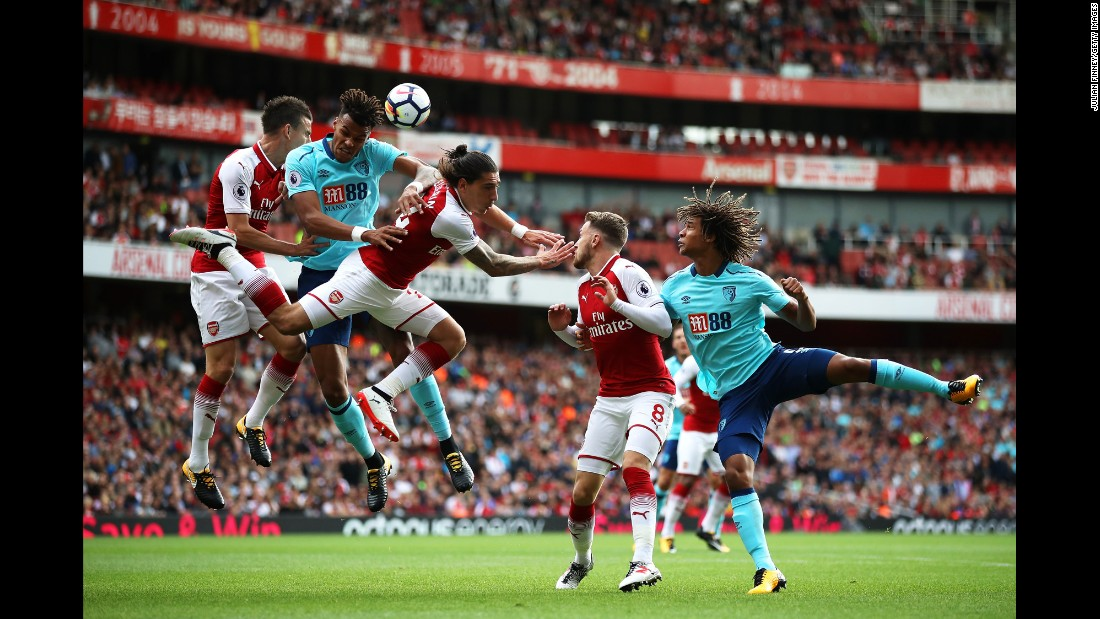 Bournemouth defender Tyrone Mings rises for a header with two Arsenal players during a Premier League match in London on Saturday, September 9.