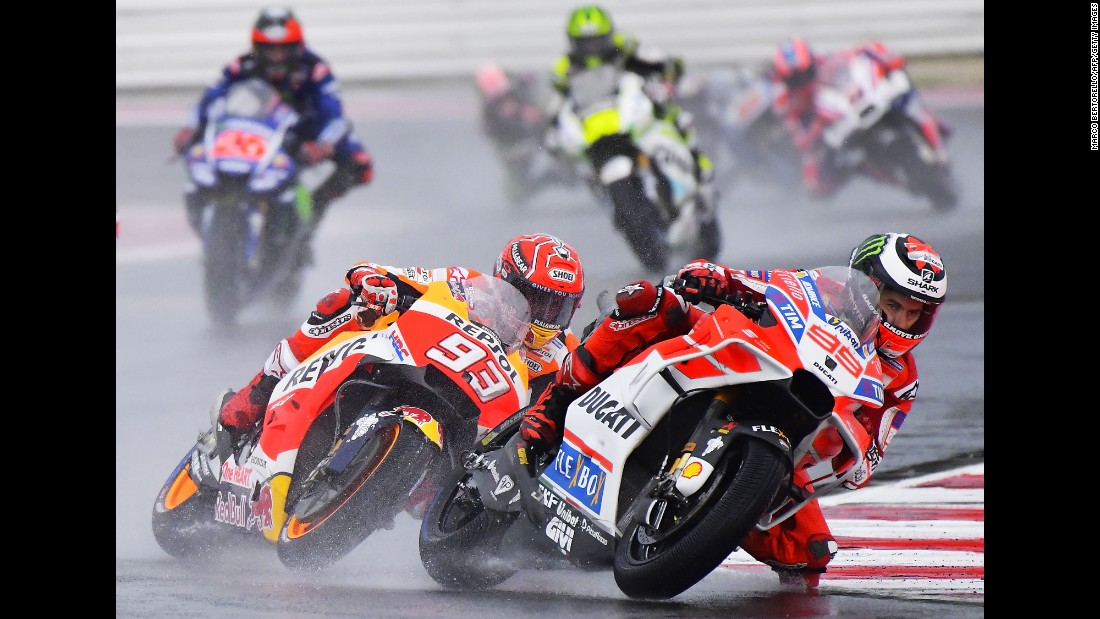 MotoGP riders Marc Marquez, left, and Jorge Lorenzo compete during the San Marino Grand Prix on Sunday, September 10. Marquez would go on to win the race. Lorenzo crashed and finished in 23rd place.