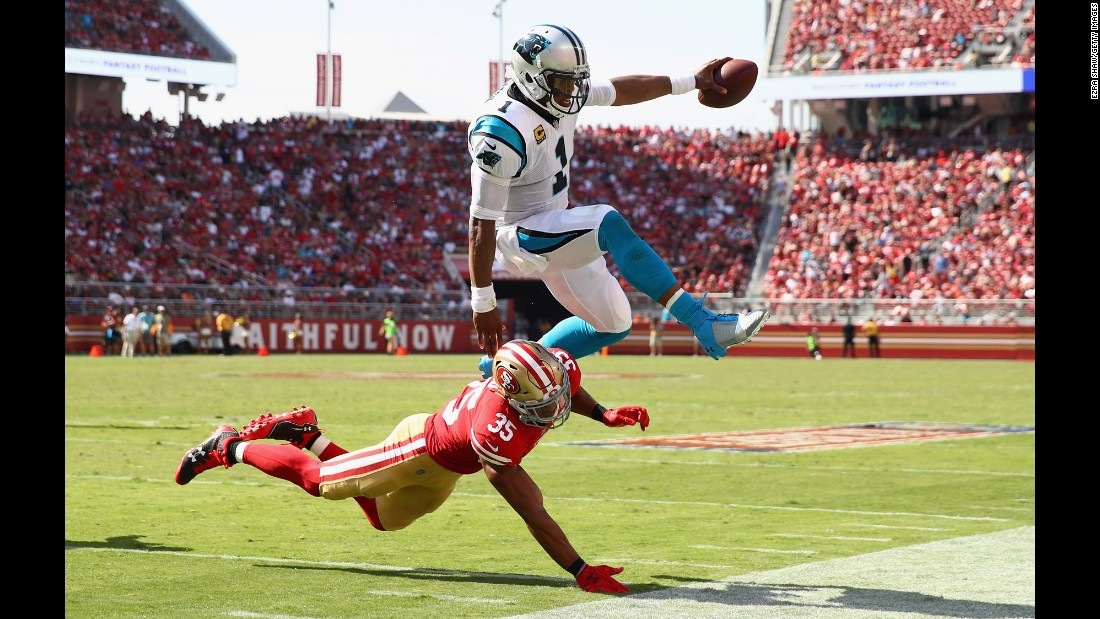Carolina quarterback Cam Newton jumps over San Francisco safety Eric Reid during their season-opening game on Sunday, September 10.