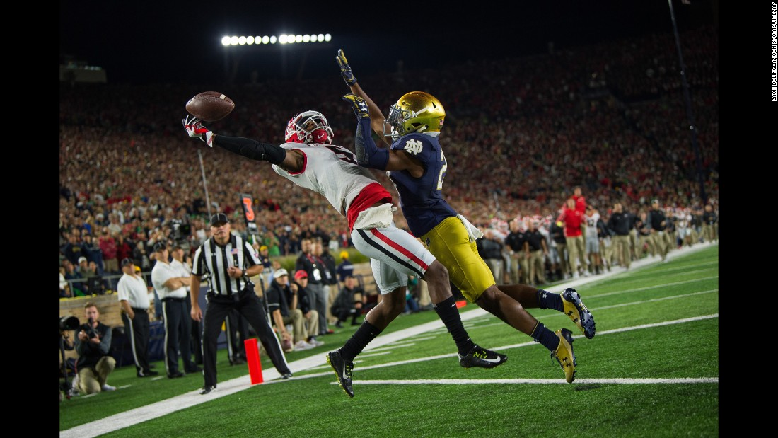 Georgia wide receiver Terry Godwin makes a one-handed touchdown catch over Notre Dame cornerback Julian Love on Saturday, September 9. Georgia edged the Fighting Irish 20-19 in South Bend, Indiana.