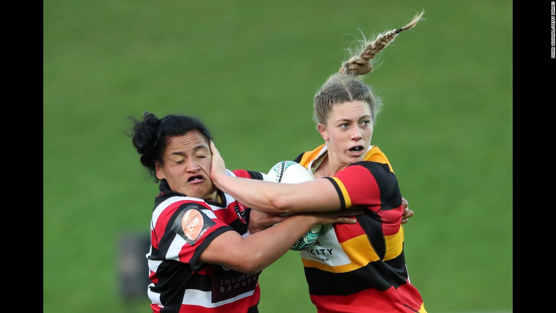 Waikato rugby player Michelle Montague fends off Victoria Subritzky during a Farah Palmer Cup match in Pukekohe, New Zealand, on Thursday, September 7.