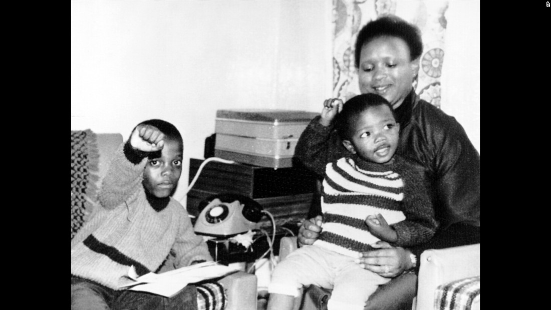 The children of Steve Biko give a Black Power salute as they sit at home with their aunt, Biko's sister Nobandile Mvovo, September 1977.