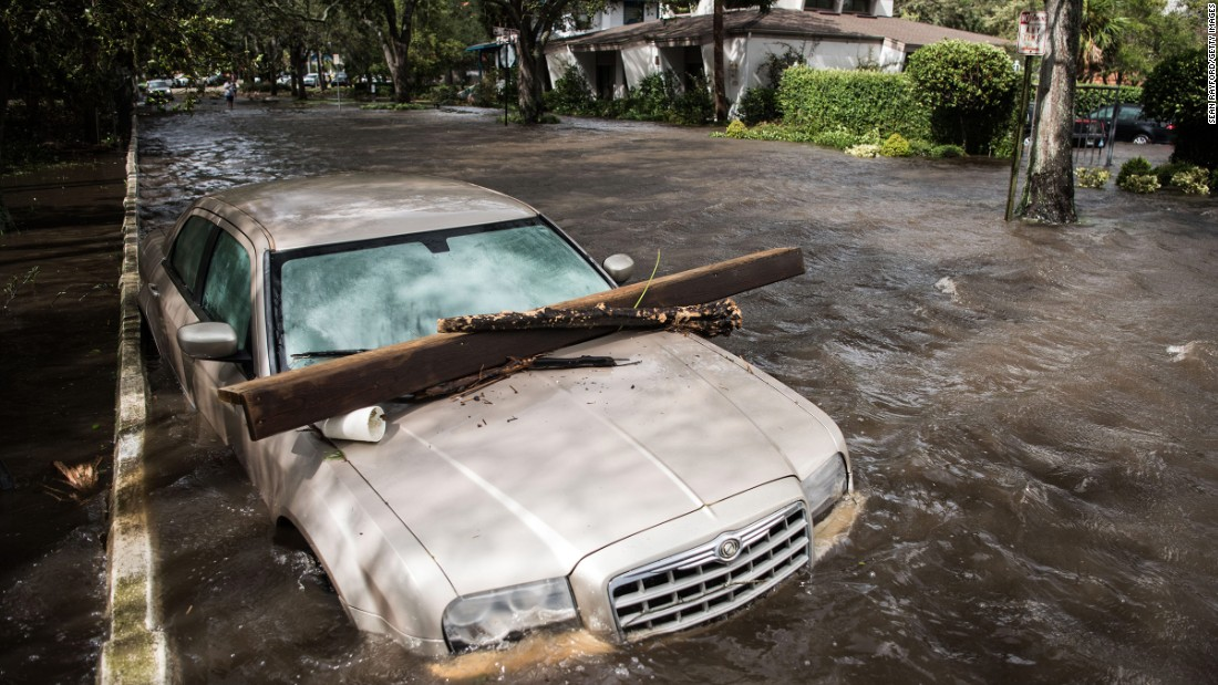 Floodwaters inundate a car in Jacksonville on September 11.