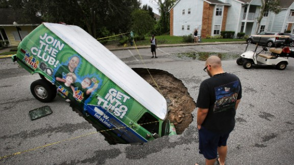 A van sits in a sinkhole that opened up in Winter Springs, Florida, on September 11.