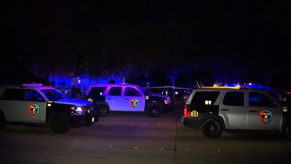Police vehicles are see outside a home in Plano, Texas, after eight people were shot dead at a gathering where people were to watch a Dallas Cowboys game on the night of Sunday, September 10, 2017.