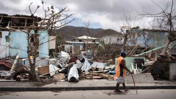 A man walks on a street on September 10, 2017 in Marigot on the island of Saint-Martin after it was devastated by Irma hurricane. / AFP PHOTO / Martin BUREAU        (Photo credit should read MARTIN BUREAU/AFP/Getty Images)