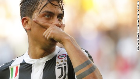 Juventus' Argentinian forward Paulo Dybala  celebrates after scoring during a goal  during the Italian Serie A football match Juventus vs Cagliari on August 19, 2017 at the Allianz Stadium in Turin. / AFP PHOTO / Marco BERTORELLO        (Photo credit should read MARCO BERTORELLO/AFP/Getty Images)