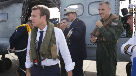 Emmanuel Macron waits on the tarmac in Guadeloupe before boarding a helicopter to St. Martin.