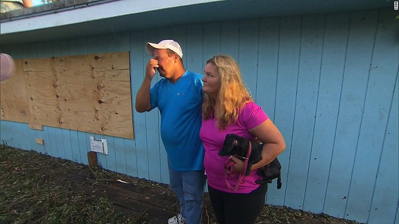 Emotional residents return to devastated homes