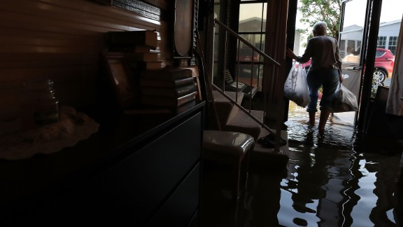 BONITA SPRINGS, FL - SEPTEMBER 12: Carolyn Cole removes her belongings from her home that was flooded by Hurricane Irma on September 12, 2017 in Bonita Springs, Florida. On Sunday Hurricane Irma hit Florida's west coast leaving widespread power outages and flooding.  (Photo by Mark Wilson/Getty Images)