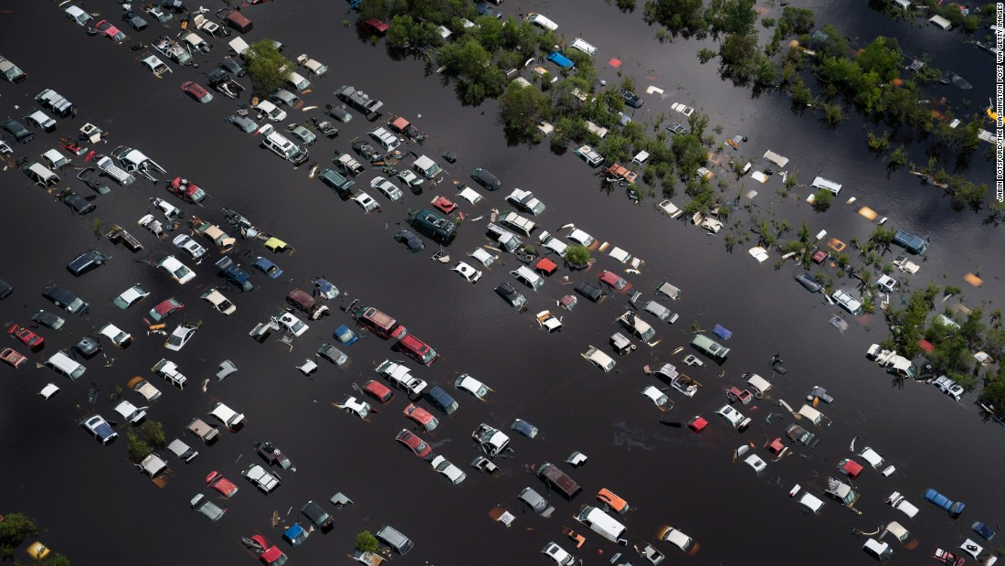 Floodwaters surround vehicles in Callahan, Florida, on Tuesday, September 12.