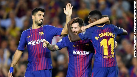 BARCELONA, SPAIN - SEPTEMBER 12:  Lionel Messi of Barcelona celebrates scoring his sides third goal with Ousmane Dembele of Barcelona and Luis Suarez of Barcelona during the UEFA Champions League Group D match between FC Barcelona and Juventus at Camp Nou on September 12, 2017 in Barcelona, Spain.  (Photo by David Ramos/Getty Images)