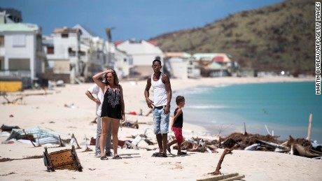 TOPSHOT - People inspect the damage on the Grand-Case Bay beach on September 11, 2017 on the French Caribbean island of Saint-Martin after it was hit by Hurricane Irma. / AFP PHOTO / Martin BUREAU        (Photo credit should read MARTIN BUREAU/AFP/Getty Images)