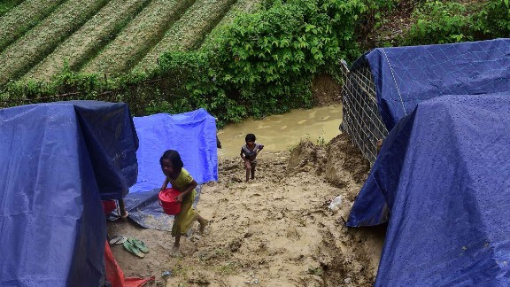 A Rohingya girl carries supplies on September 9, at a refugee camp in Ukhia, Bangladesh.