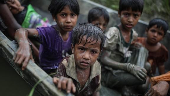 Rohingya children flee the Rakhine state by boat on Tuesday, September 12.