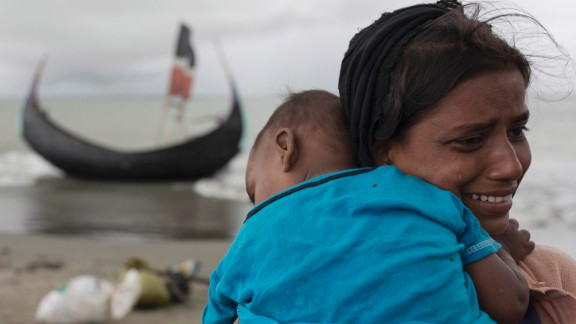 A Rohingya woman cries after the boat crash in Dakhinpara on September 12.