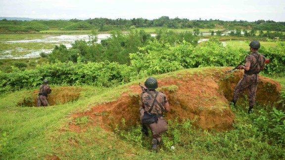 Bangladeshi border guards stand watch on August 26, as Rohingya refugees escape fresh gunfire near Myanmar's Rakhine state.