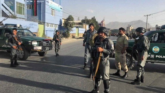 Afghan police stand guard near the site of the bombing outside a cricket stadium in Kabul.