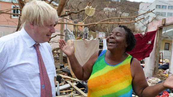 UK Foreign Secretary Boris Johnson talks to a resident of Anguilla during a visit on September 13.