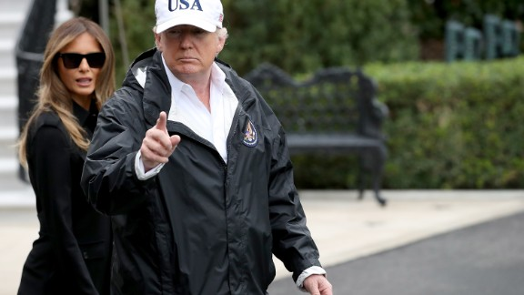WASHINGTON, DC - SEPTEMBER 14:  U.S. President Donald Trump, with first lady Melania Trump, gestures as he answers questions while departing the White House September 14, 2017 in Washington, DC. Trump spoke on reports from a meeting with Democratic leaders last night about a proposed deal on DACA and potentially delaying negotiations on his efforts to build a wall on the U.S. border with Mexico. Trump is scheduled to visit Florida today to view relief efforts in the wake of Hurricane Irma.  (Photo by Win McNamee/Getty Images)
