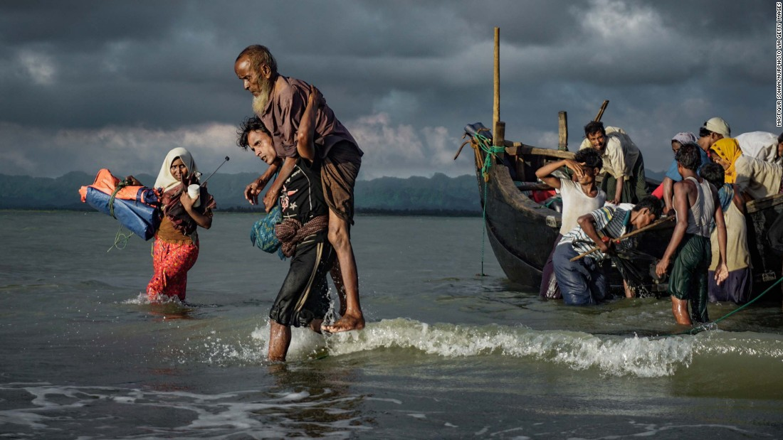 Rohingya refugees disembark from a boat on September 13 on the Bangladeshi side of the Naf River.