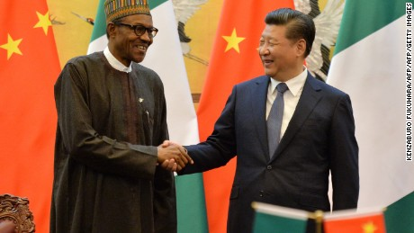 Nigerian President Muhammadu Buhari and Chinese President Xi Jinping shake hands at a meeting in 2016.
