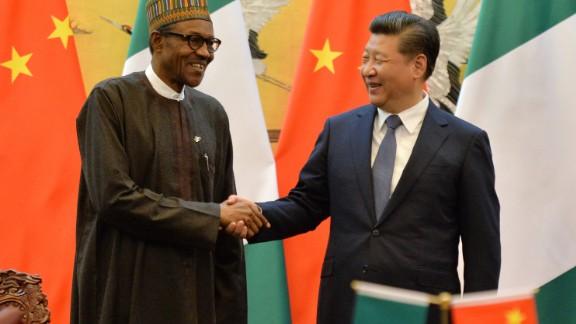 Nigerian President Muhammadu Buhari and Chinese President Xi Jinping shake hands at a meeting in 2016.
