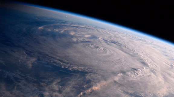 FILE - This photo made available by NASA shows Hurricane Harvey over Texas on Saturday, Aug. 26, 2017, seen from the International Space Station. Experts say a combination of unusual factors turned Harvey into a deadly monster. The storm intensified just before it hit land, parked itself over one unfortunate area and dumped a record amount of rain. (Randy Bresnik/NASA via AP)