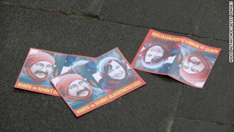 Leaflets bearing pictures of the two hunger-strikers are seen on a street after a support demonstration in the Turkish capital of Ankara on June 3.