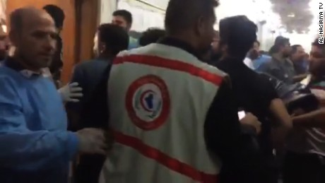 Footage from Al-Nasiriya TV showed a hectic scene of the injured arriving at the al-Hussein Educational Hospital.