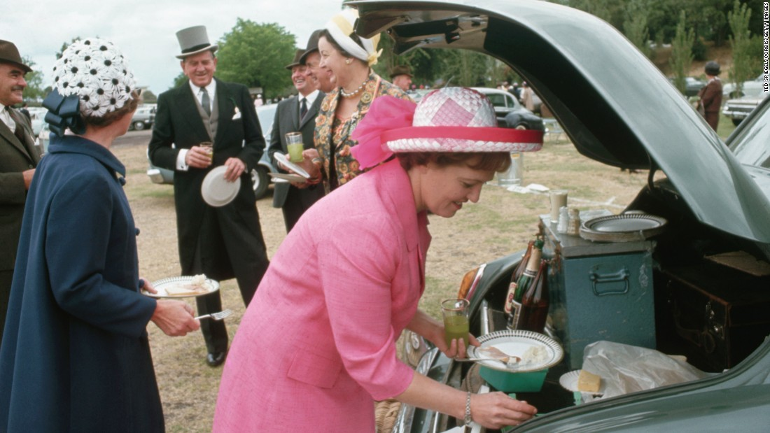 And, tailgating isn't just an American tradition: in this undated photo, these fancy-hatted spectators gather to eat and drink before the Melbourne Cup horse race in Melbourne, Australia.