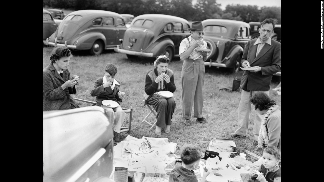 "Sports fans started getting together to eat before a big game as far back as the 19th century. When cars became commonplace, these pre-game parties popped up in parking lots outside game venues - and the term ""tailgating"" emerged. Here, tailgaters in 1940s Chicago enjoy a picnic in the parking lot."