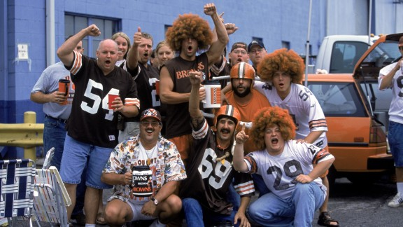CLEVELAND - SEPTEMBER 15: Tailgating fans of the Cleveland Browns pose for a group portrait outside of the stadium before the NFL game against the Cincinnati Bengals on September 15, 2002 at Cleveland Browns Stadium in Cleveland, Ohio. The Browns won 20-7. (Photo by Paul Spinelli/Getty Images)