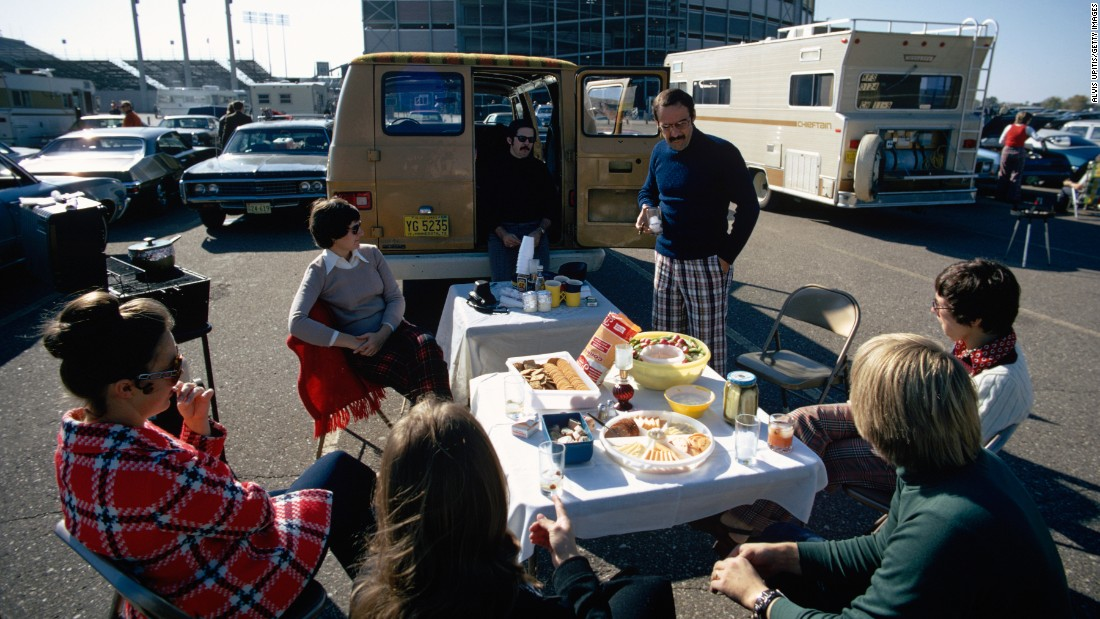 Minnesota Vikings fans tailgate in a parking lot outside Metropolitan Stadium in Bloomington, Minnesota, before an NFL game in 1973.