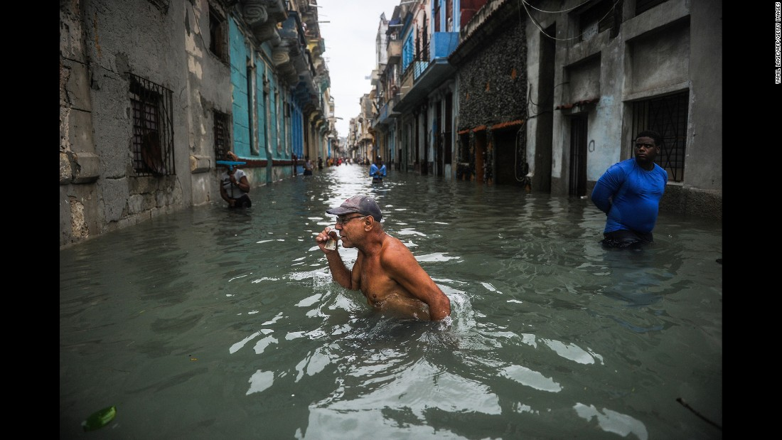 A man wades through a flooded street in Havana, Cuba, on Sunday, September 10. Hurricane Irma battered central Cuba before moving toward Florida.