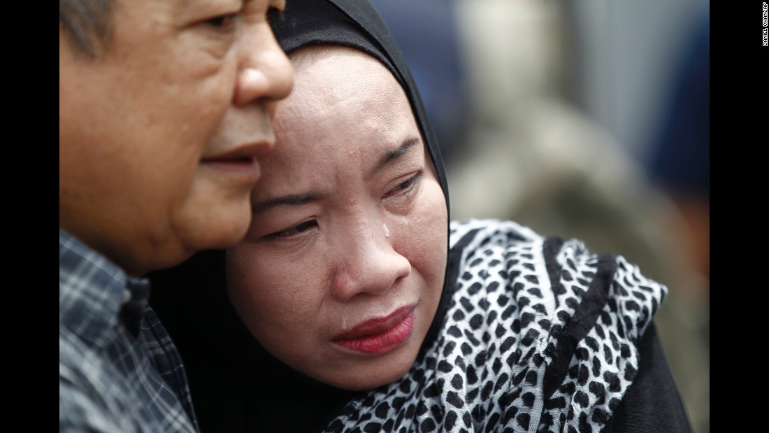 "A woman cries after <a href=""http://www.cnn.com/2017/09/13/asia/malaysia-school-fire/index.html"" target=""_blank"">a deadly school fire</a> in Kuala Lumpur, Malaysia, on Thursday, September 14. At least 21 students and two adults were killed. Investigators were examining whether an electric short circuit caused the fire."