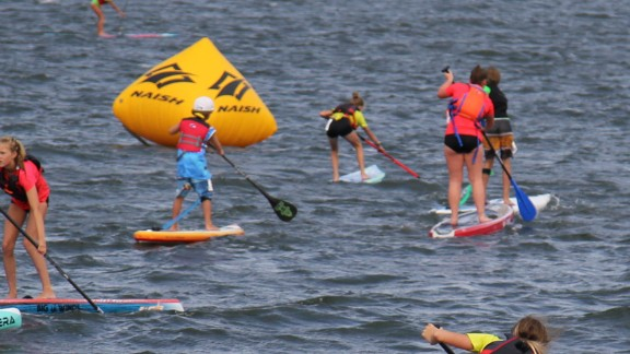 Being competative in a SUP course race around  buoys requires speed, stamina and agility.