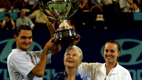 Roger Federer and Martina Hingis pose with the 2001 Hopman Cup trophy.