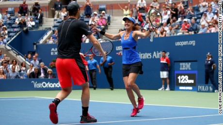 Martina Hingis celebrates winning the 2017 US Open mixed doubles with partner Jamie Murray.