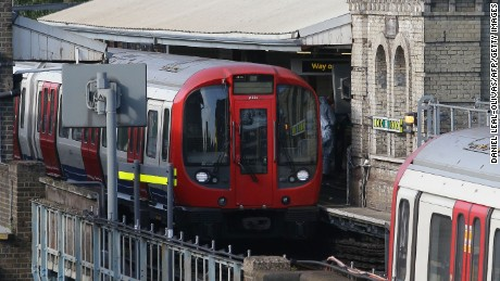 "Members of the emergency services work alongside an underground tube train at a platform at Parsons Green underground tube station in west London on September 15, 2017, following an incident on an underground tube carriage at the station. Police and ambulance services said they were responding to an ""incident"" at Parsons Green underground station in west London on Friday, following media reports of an explosion. ""We are aware of an incident at Parsons Green tube station. Officers are in attendance,"" London's Metropolitan Police said on Twitter. / AFP PHOTO / Daniel LEAL-OLIVAS        (Photo credit should read DANIEL LEAL-OLIVAS/AFP/Getty Images)"