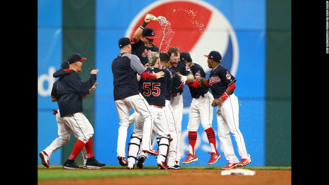 "Teammates pile on Jay Bruce of the Cleveland Indians after his 10th-inning double defeated the Kansas City Royals on Thursday, September 14. The <a href=""http://bleacherreport.com/articles/2733297-indians-extend-winning-streak-to-22-games-with-extra-innings-win-vs-royals"" target=""_blank"">3-2 walk-off victory</a> extended the Tribe's winning streak to 22 games, just four short of the all-time major league record."